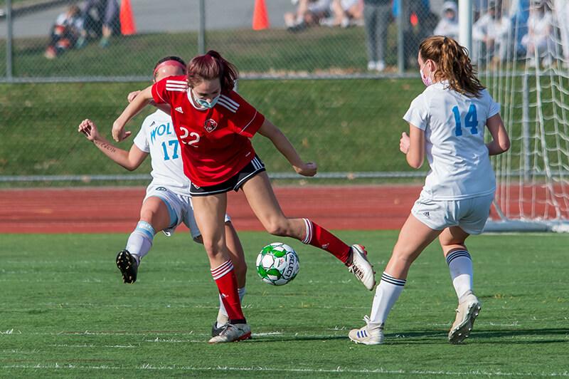 Josie Pecor splits the defense. Photo by Al Frey