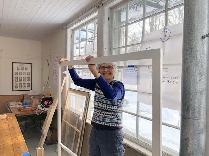 "Ruah Swennerfelt helps ""dress"" the windows. Photo contributed"